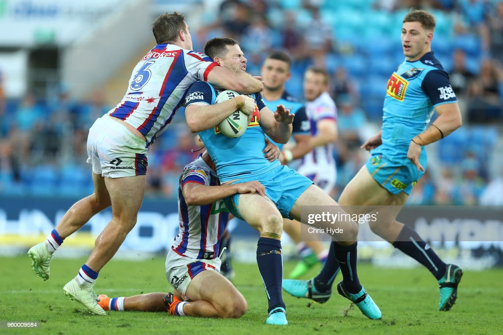 Anthony Don of the Titans is tackled by Connor Watson of the Knights during the round 11 NRL match between the Gold Coast Titans and the Newcastle Knights at Cbus Super Stadium on May 19, 2018 in Gold Coast, Australia.