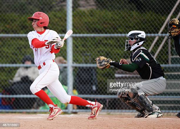 Anthony Donovan of Regis Jesuit High School singles from Nick Leonard of Mountain Vista High School at Regis Jesuit High School Aurora Colorado April...