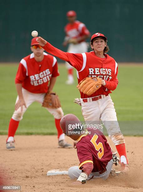 Anthony Donovan of Regis Jesuit High School tag Nathan Elsheimer of Rocky Mountain High School during 5A state championship game at All City Stadium...