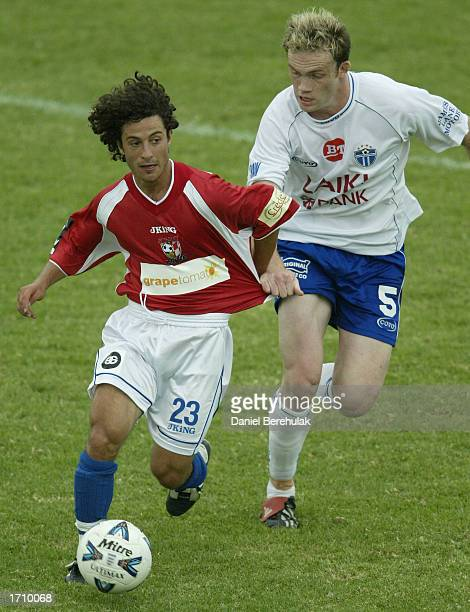 Anthony Doumanis of United is challenged by Robert Liparoti of South Melbourne during the NSL round 16 match between Sydney United and South...