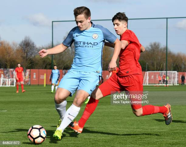 Anthony DriscollGlennon of Liverpool and Luke Bolton of Manchester City in action during the Liverpool v Manchester City U18 Premier League game at...
