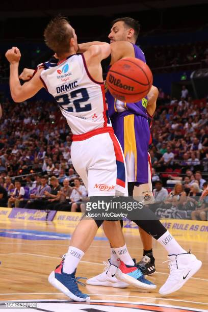 Anthony Drmic of the 36ers is fouled by Andrew Bogut of the Kings during the round 14 NBL match between the Sydney Kings and the Adelaide 36ers at...