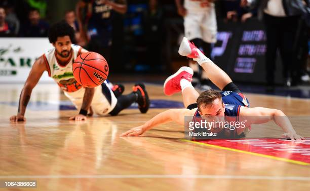 Anthony Drmic of the Adelaide 36ers tripped by Melo Trimble of the Taipans during the round seven NBL match between the Adelaide 36ers and the Cairns...