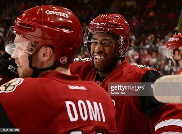Anthony Duclair of the Arizona Coyotes and teammate Max Domi talk during a stop in play against the Edmonton Oilers at Gila River Arena on January 12...