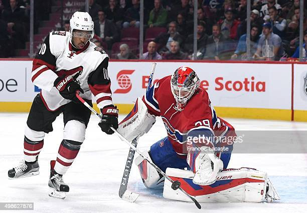 Anthony Duclair of the Arizona Coyotes attempts to deflect the puck against Mike Condon of the Montreal Canadiens in the NHL game at the Bell Centre...
