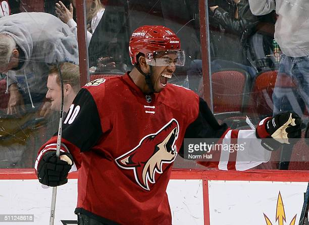 Anthony Duclair of the Arizona Coyotes celebrates a goal against the Dallas Stars by teammate Max Domi during the second period at Gila River Arena...
