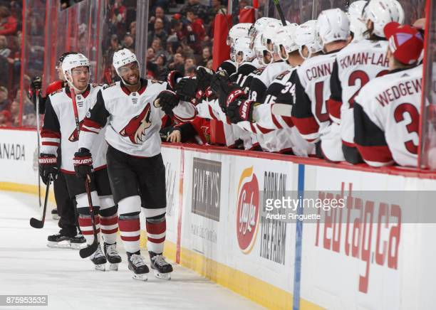 Anthony Duclair of the Arizona Coyotes celebrates a third period goal against the Ottawa Senators with teammates at the players bench at Canadian...