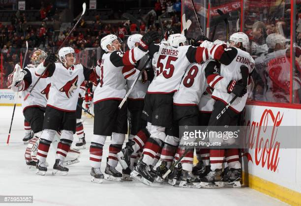 Anthony Duclair of the Arizona Coyotes celebrates his the overtime winning and a natural hattrick goal against the Ottawa Senators with teammates at...