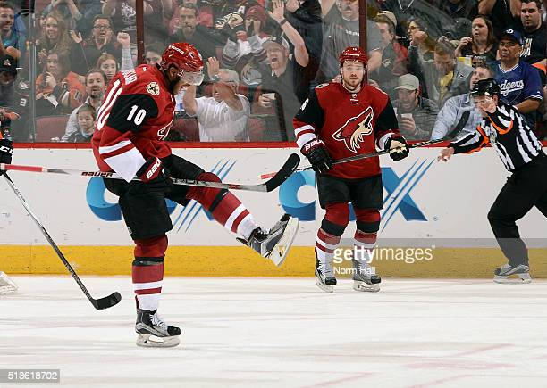 Anthony Duclair of the Arizona Coyotes celebrates in front of teammate Max Domi after his second period goal against the Anaheim Ducks at Gila River...