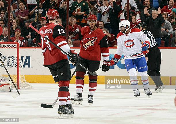 Anthony Duclair of the Arizona Coyotes celebrates with teammate Oliver EkmanLarsson after a second period goal against the Montreal Canadiens at Gila...