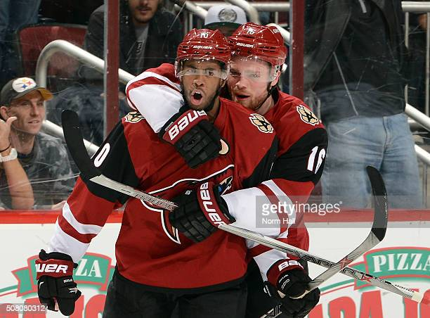Anthony Duclair of the Arizona Coyotes celebrates with teammate Max Domi after his second period goal against the Los Angeles Kings at Gila River...