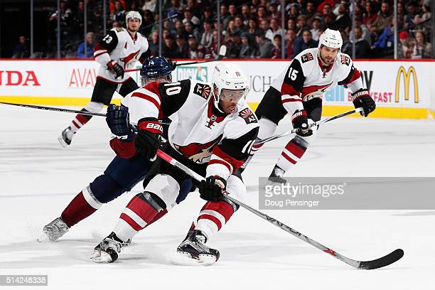 Anthony Duclair of the Arizona Coyotes controls the puck against Blake Comeau of the Colorado Avalanche at Pepsi Center on March 7 2016 in Denver...