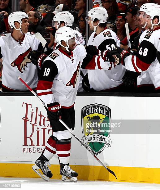 Anthony Duclair of the Arizona Coyotes is congratulated by his teammates after scoring his second goal in the first period during the game against...