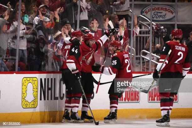 Anthony Duclair of the Arizona Coyotes is congratulated by Kevin Connauton Freddie Hamilton and Luke Schenn after Duclair scored a goal against the...