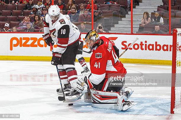 Anthony Duclair of the Arizona Coyotes looks for a rebound as Craig Anderson of the Ottawa Senators makes a save during an NHL game at Canadian Tire...