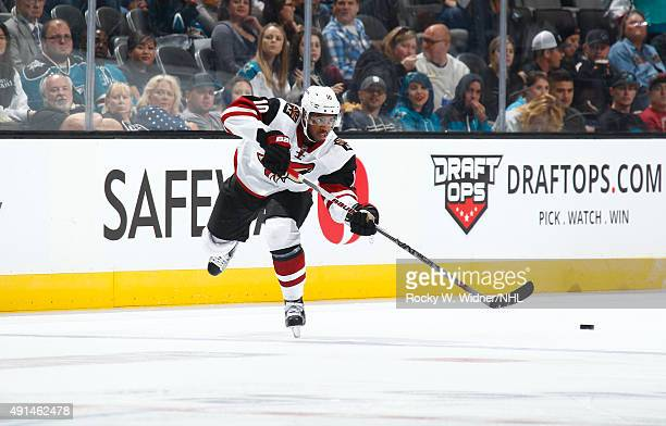 Anthony Duclair of the Arizona Coyotes passes the puck against the San Jose Sharks at SAP Center on September 25 2015 in San Jose California