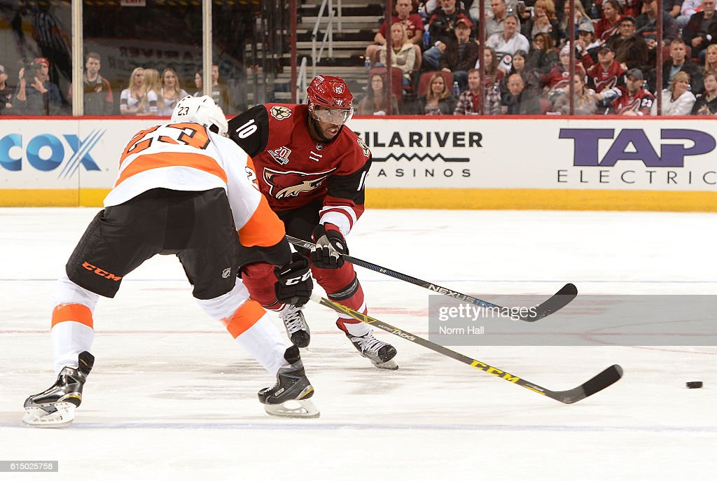 Anthony Duclair #10 of the Arizona Coyotes passes the puck up ice against the Philadelphia Flyers at Gila River Arena on October 15, 2016 in Glendale, Arizona. Duclair is playing in his 100th NHL game.