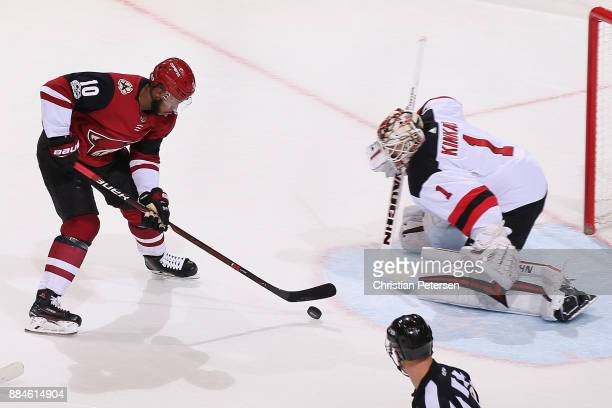 Anthony Duclair of the Arizona Coyotes skates in on goaltender Keith Kinkaid of the New Jersey Devils during the third period of the NHL game at Gila...