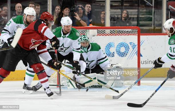 Anthony Duclair of the Arizona Coyotes tries to get a shot off on goalie Ben Bishop of the Dallas Stars as Marc Methot and Martin Hanzal of the Stars...