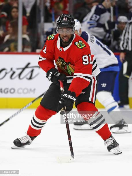 Anthony Duclair of the Chicago Blackhawks advances the puck against the Winnipeg Jets at the United Center on January 12 2018 in Chicago Illinois The...
