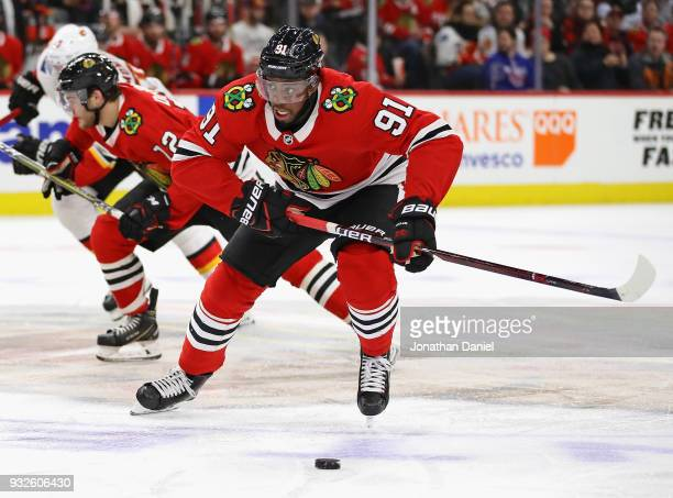 Anthony Duclair of the Chicago Blackhawks chases the puck against the Calgary Flames at the United Center on February 6 2018 in Chicago Illinois The...