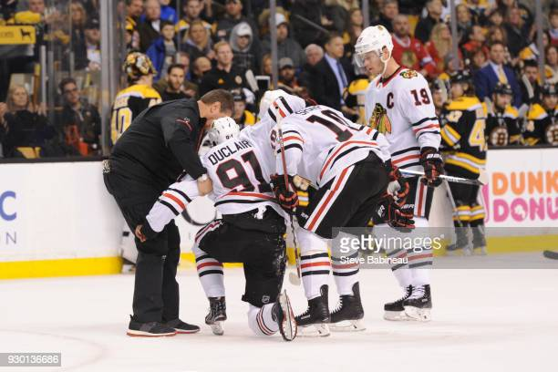 Anthony Duclair of the Chicago Blackhawks gets helped off the ice after a play against the Boston Bruins at the TD Garden on March 10 2018 in Boston...