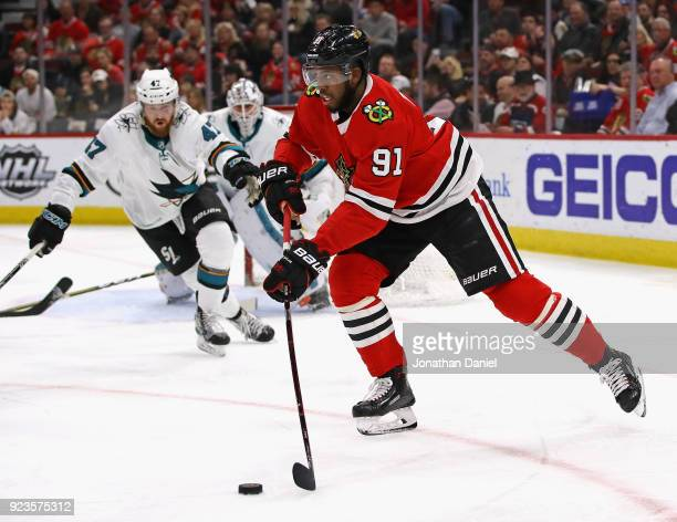 Anthony Duclair of the Chicago Blackhawks looks to pass against the San Jose Sharks at the United Center on February 23 2018 in Chicago Illinois
