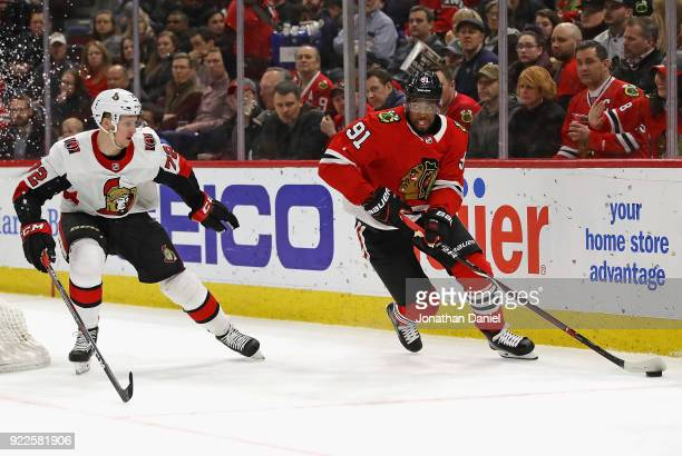 Anthony Duclair of the Chicago Blackhawks looks to pass under pressure from Thomas Chabot of the Ottawa Senators at the United Center on February 21...