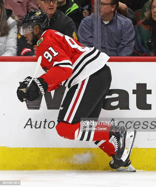 Anthony Duclair of the Chicago Blackhawks skates against the Winnipeg Jets at the United Center on January 12 2018 in Chicago Illinois