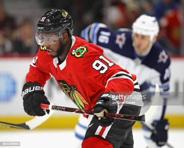Anthony Duclair of the Chicago Blackhawks skates to the puck after a faceoff against the Winnipeg Jets at the United Center on January 12 2018 in...