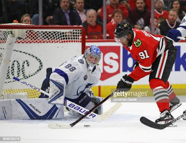 Anthony Duclair of the Chicago Blackhawks tries to get off a shot against Andrei Vasilevskiy of the Tampa Bay Lightning at the United Center on...