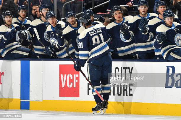 Anthony Duclair of the Columbus Blue Jackets is congratulated by his teammates after scoring a goal during the first period of the game against the...