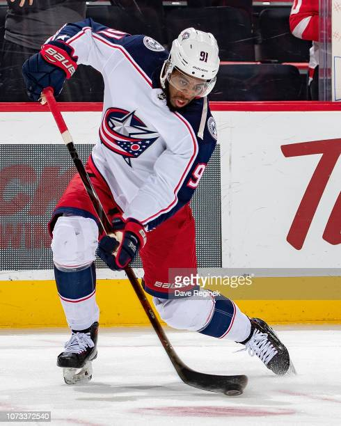 Anthony Duclair of the Columbus Blue Jackets shoots the puck in warm ups prior to an NHL game against the Detroit Red Wings at Little Caesars Arena...