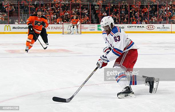 Anthony Duclair of the New York Rangers skates the puck against Nicklas Grossmann of the Philadelphia Flyers on November 28 2014 at the Wells Fargo...