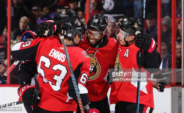 Anthony Duclair of the Ottawa Senators celebrates his powerplay goal against the New York Rangers with team mates Tyler Ennis and JeanGabriel Pageau...