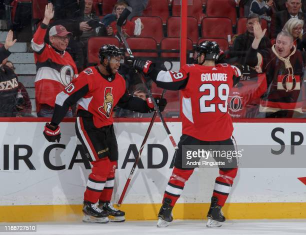 Anthony Duclair of the Ottawa Senators celebrates his second of two first period goals against the Columbus Blue Jackets with teammate Cody Goloubef...