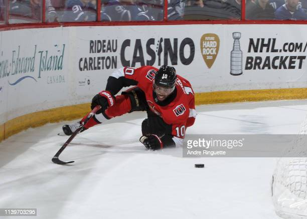 Anthony Duclair of the Ottawa Senators falls to the ice with the puck against the Toronto Maple Leafs at Canadian Tire Centre on March 30 2019 in...