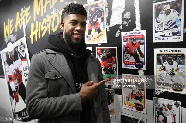 Anthony Duclair of the Ottawa Senators points to his photo on the wall at the NHL Black History Month Truck Tour at Winterfest in Keiner Plaza on...