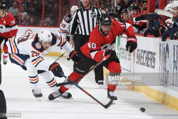 Anthony Duclair of the Ottawa Senators skates up ice with the puck against Leon Draisaitl of the Edmonton Oilers at Canadian Tire Centre on February...