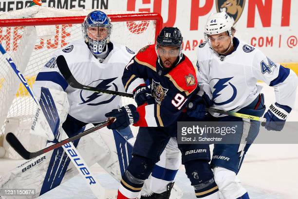 Anthony Duclair of the Panthers crosses sticks with Jan Rutta of the Tampa Bay Lightning at the BB&T Center on February 13, 2021 in Sunrise, Florida.
