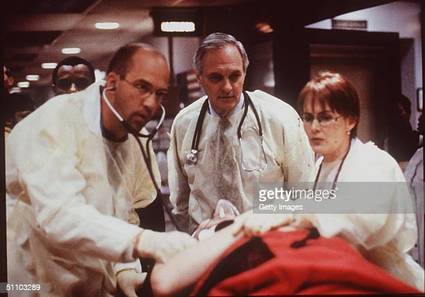 "Anthony Edwards, Alan Alda, And Laura Innes In ""Er."""