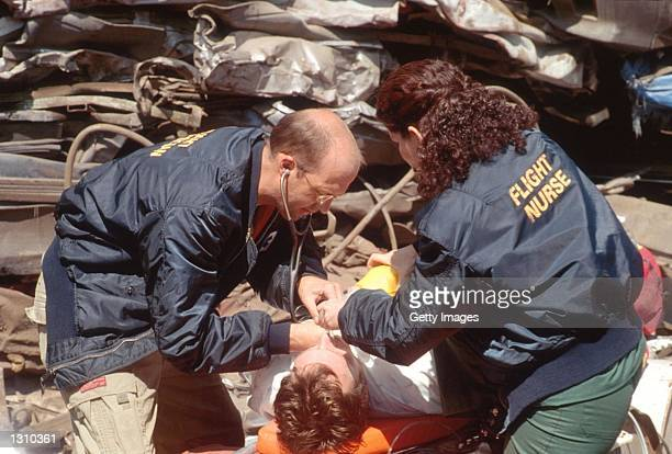 """Anthony Edwards as and Julianna Margulies as act in a scene from """"ER"""" ."""