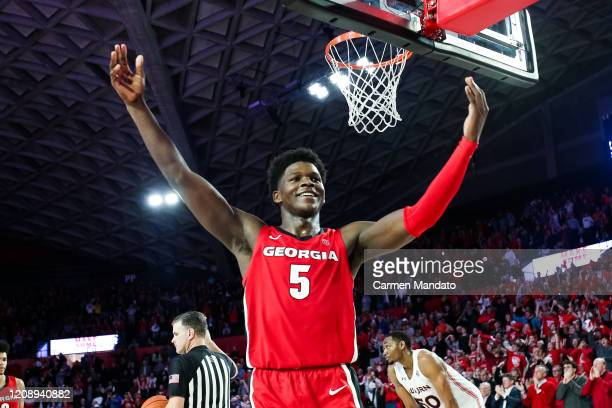 Anthony Edwards of the Georgia Bulldogs gestures to the crowd in the final minutes of a game against the Auburn Tigers at Stegeman Coliseum on...