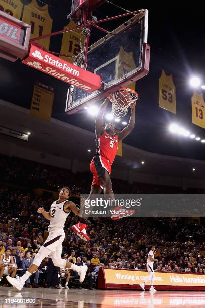 Anthony Edwards of the Georgia Bulldogs slam dunks the ball ahead of Rob Edwards of the Arizona State Sun Devils during the first half of the NCAAB...