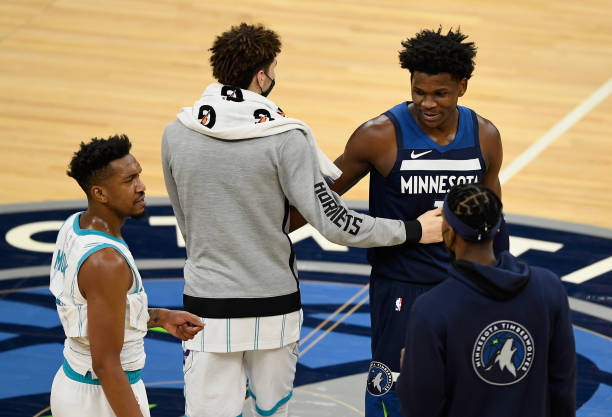 Anthony Edwards of the Minnesota Timberwolves speaks to LaMelo Ball of the Charlotte Hornets after the game at Target Center on March 3, 2021 in...