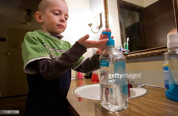 Anthony Edwards uses hand sanitizer at home in Overland Park Kansas on October 23 2009 Anthony's mom Teresa Edwards is worried about swine flu and is...