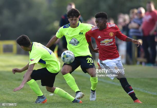Anthony Elanga of Manchester United and Felipe Orostica of Colina during the NI Super Cup junior section game between Manchester United and Colina at...