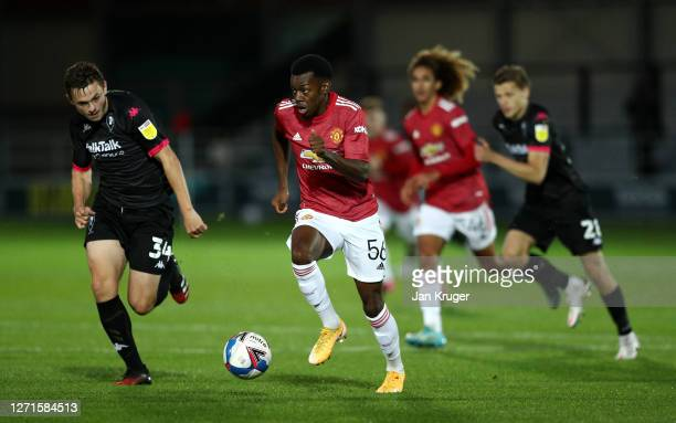 Anthony Elanga of Manchester United U21 battles with Alex Doyle of Salford City Football Club during the EFL Trophy match between Salford and...