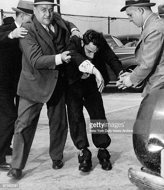 Anthony Esposito is restrained by police after he attempted to grab the wheel from a driver near the gates of Sing Sing prison