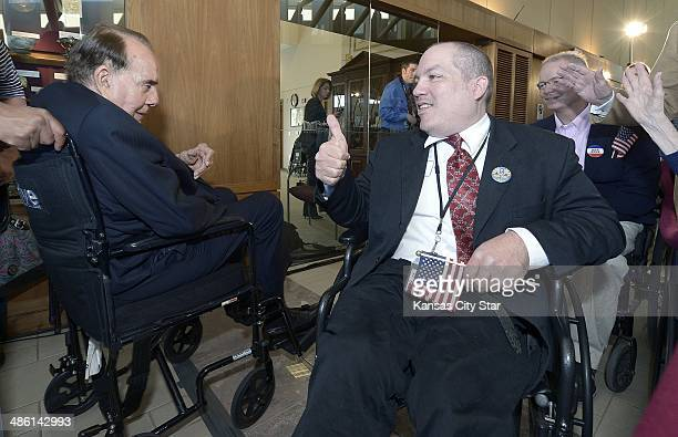 Anthony Fadale, right, the Kansas State ADA Coordinator in Topeka, Kan, gives a thumbs up to former Kansas Sen. Bob Dole during Dole's visit to the...